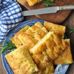 Plate of focaccia bread garnished with fresh rosemary