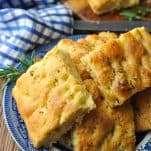 Front shot of homemade focaccia bread recipe on a blue and white plate