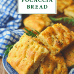 Focaccia bread on a plate with text title box at top