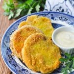 Plate of fried green tomatoes with creamy dip