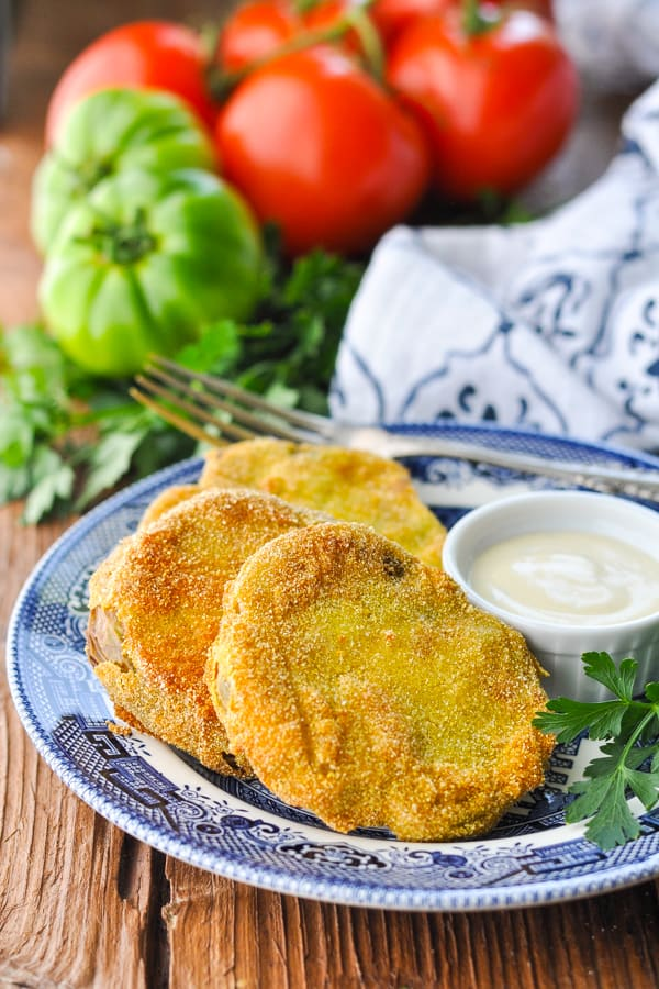 Front shot of fried green tomatoes on a blue and white plate