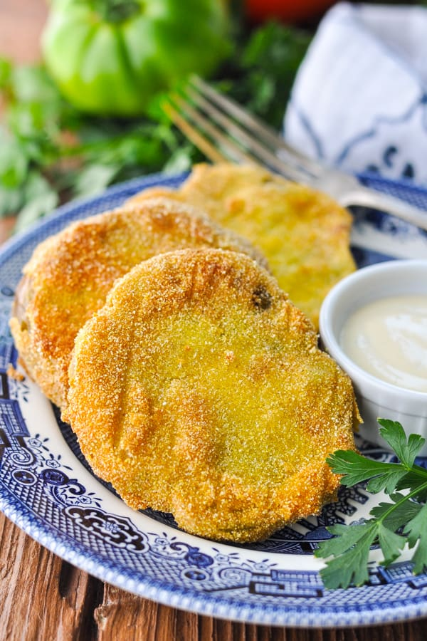 Close up front shot of a plate of fried green tomatoes