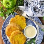 Overhead shot of fried green tomatoes on a blue and white plate