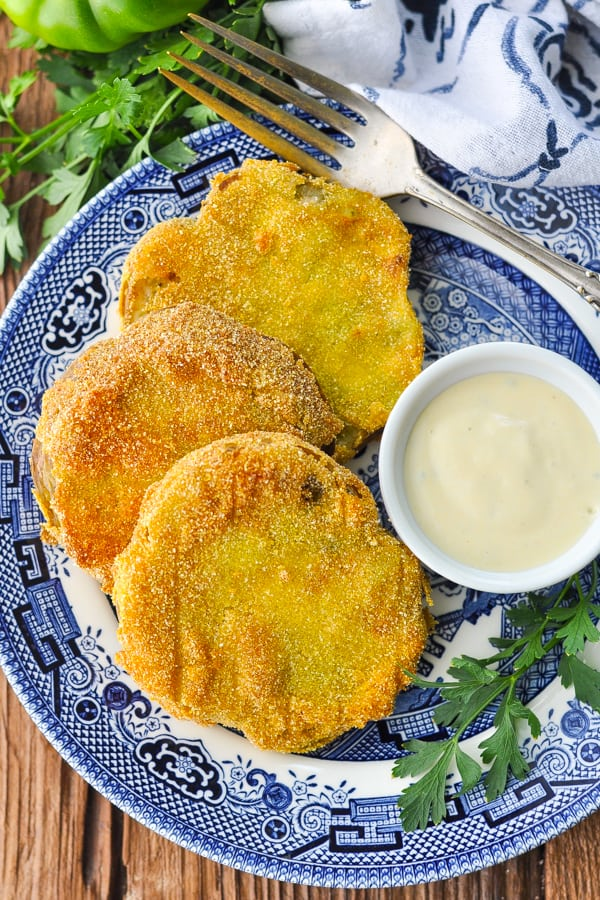 Overhead shot of plate of fried green tomatoes with buttermilk dip