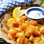 Front shot of a basket of southern fried shrimp served with tartar sauce