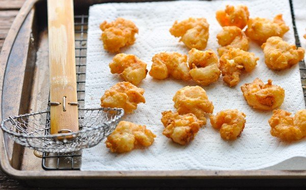 Fried shrimp draining on paper towels