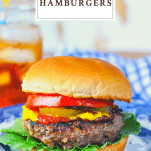 Front shot of grilled hamburgers on a blue and white plate with a text title box at the top