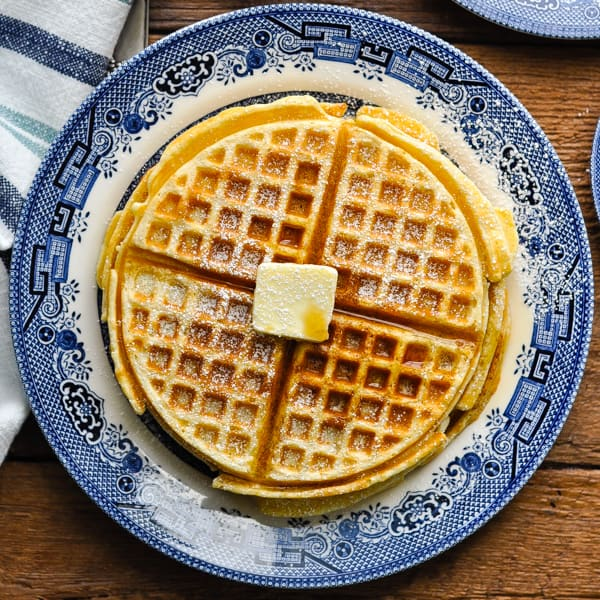 Square image overhead of a plate of homemade waffles