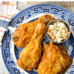 Overhead image of crispy fried chicken recipe on a plate with text title at top