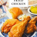 Front shot of southern fried chicken recipe on a plate with a text title box at the top