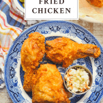 Overhead shot of a plate of homemade fried chicken with text title box at top