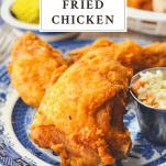 Front shot of fried chicken on a plate with text title box at the top