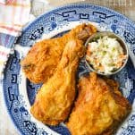 Overhead image of homemade fried chicken with a side of coleslaw