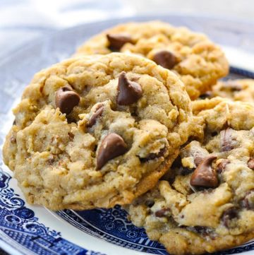 Close up side shot of a plate of soft and chewy oatmeal chocolate chip cookies