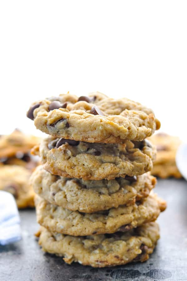Front shot of a stack of chewy oatmeal chocolate chip cookies