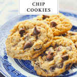Front shot of a plate of oatmeal chocolate chip cookies with a text title at the top