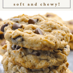 Close up shot of a stack of chewy oatmeal chocolate chip cookies with a text title at the top