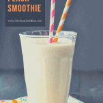 Front shot of a glass of peach smoothie with title at top of image