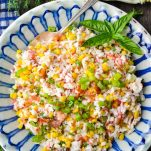 Close overhead shot of summer rice salad with fresh corn and bacon