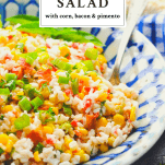 Close up shot of summer rice salad with text title at the top of the image