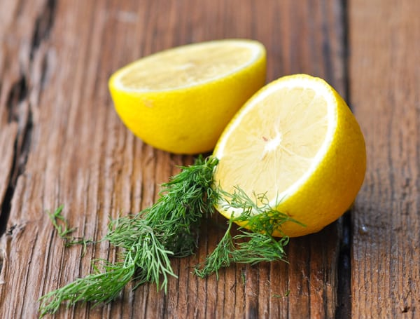 Lemon and fresh dill on a wooden table