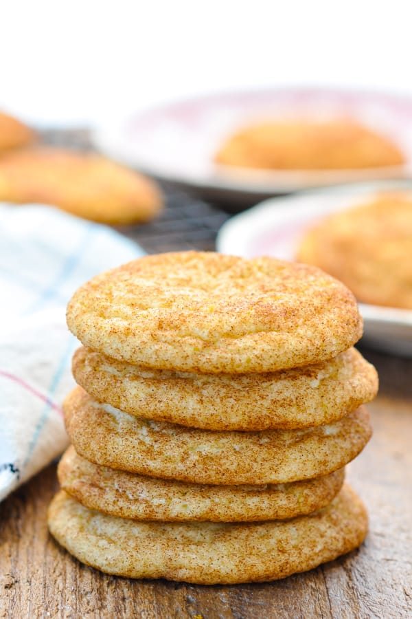 A stack of five snickerdoodle cookies on a wooden table