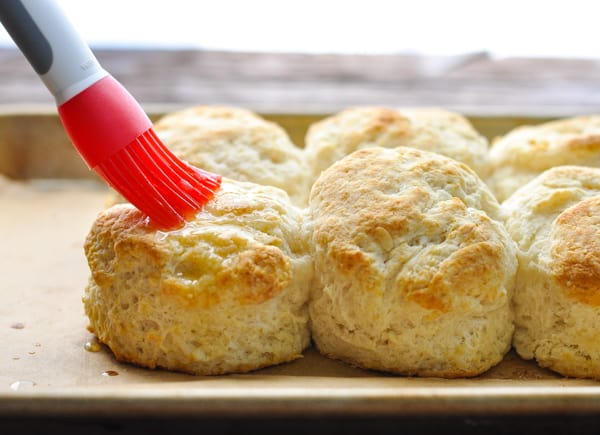 Brushing buttermilk biscuits with butter