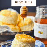 Drizzling honey on a buttermilk biscuit with text title at top