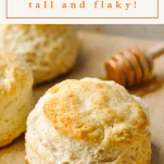 Front shot of a flaky buttermilk biscuit with text title box at the top of the image
