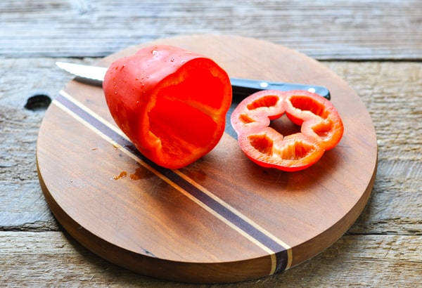 Process shot showing how to cut peppers for stuffed peppers