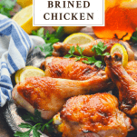 Roasted brined chicken on a plate with text title box at the top