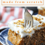 Fork digging into a bite of carrot cake with a text title box at the top