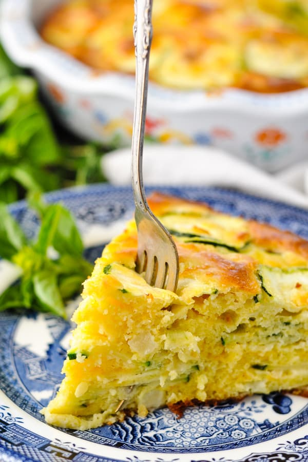 Close up shot of a fork digging into a slice of zucchini pie