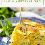 Cheesy bisquick zucchini pie with a fork and title at the top