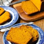 Slices of moist pumpkin bread on a blue and white serving plate