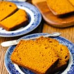 Front shot of two pieces of easy pumpkin bread on a blue and white plate