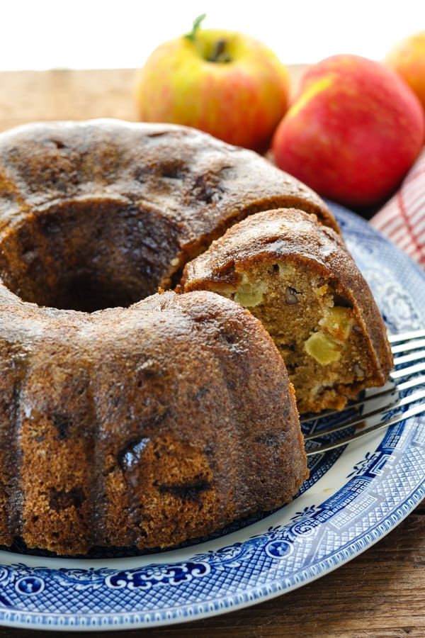 Spatula serving a slice of fresh apple cake