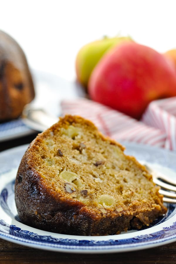 Close up side shot of a slice of moist apple cake on a plate