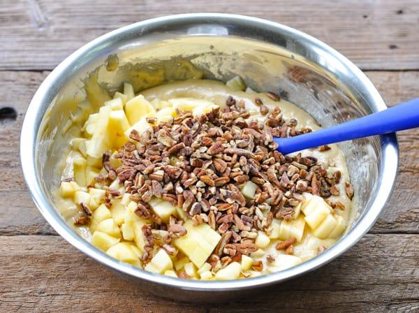 Process shot of stirring together batter for fresh apple bundt cake