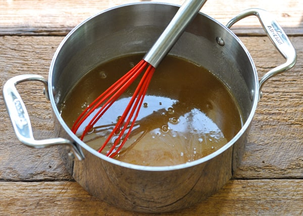 Whisking together caramel sauce in a pan