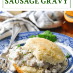 Biscuits and sausage gravy on a plate with a text title box at the top