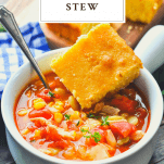 Front shot of a bowl of Brunswick Stew with a side of cornbread