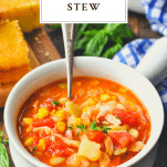 Brunswick stew recipe served in a white bowl with cornbread in the background