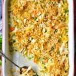 Overhead image of chicken noodle casserole from scratch in a white casserole dish with red trim