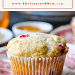 Close up shot of a cranberry muffin with a text title box at the top