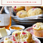 Front shot of cranberry muffins on plates with text title box at the top