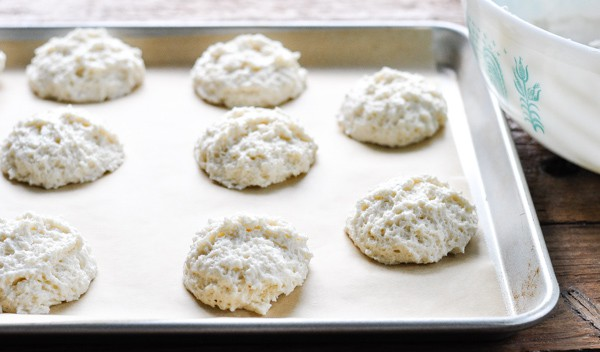 Buttermilk drop biscuits on a baking sheet before going in the oven