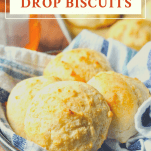 Front shot of a basket of drop biscuits with a text title at the top