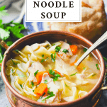 Easy Chicken Noodle Soup in a copper bowl with a text title box at the top
