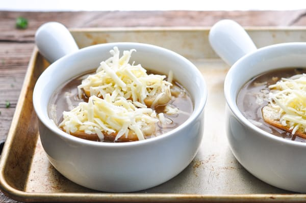 Process shot of making bowls of french onion soup